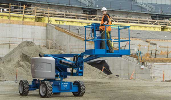 An ipaf trained operator using a genie boom lift