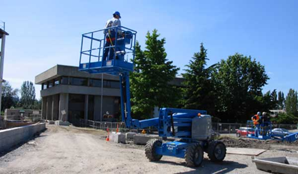 An 18m cherry picker being used to work at height outdoors