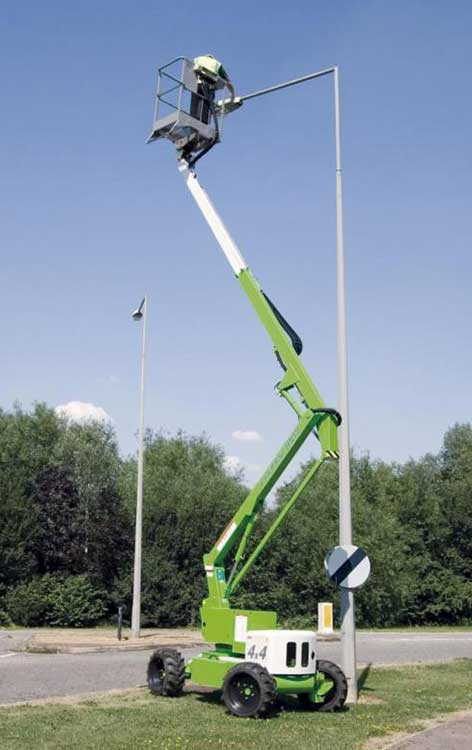 a boom lift gives access to a street light