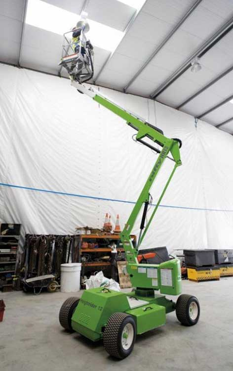 This 12m electric Bi-Energy Boom Lift is being used to gain safe access to a roof inside a warehouse