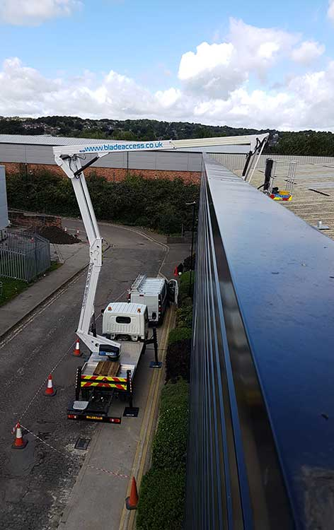 Self Drive Truck Mounted Platform Hie being used to carry out repairs on a roof