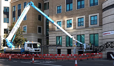 A truck mount platform being used for low level access with traffic management in place
